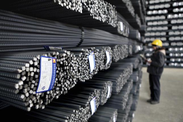 An employee checks on steel products at a factory in Lianyungang, Jiangsu province, December 24, 2013. REUTERS/Stringer