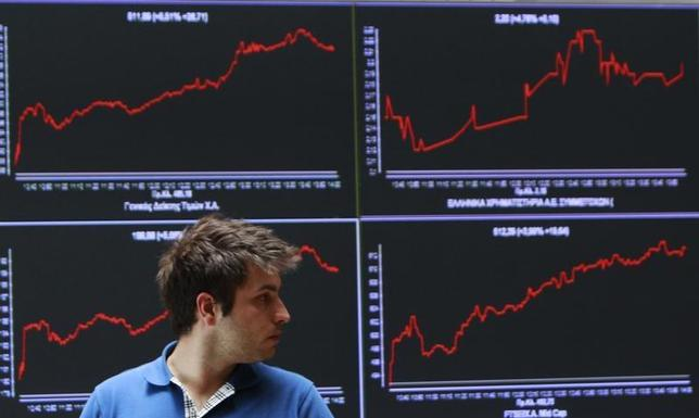 A man walks in front of an index board at the reception hall of the Athens Stock exchange May 28, 2012. REUTERS/John Kolesidis