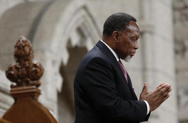 South Africa's Deputy President Kgalema Motlanthe gestures while being recognized by the Speaker in the House of Commons on Parliament Hill in Ottawa November 27, 2013. REUTERS/Chris Wattie
