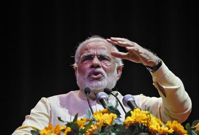 Hindu nationalist Narendra Modi, prime ministerial candidate for India's main opposition Bharatiya Janata Party (BJP) and Gujarat's chief minister, gestures as he addresses a gathering during the Confederation of All India Traders (CAIT) national convention in New Delhi February 27, 2014. REUTERS/Stringer
