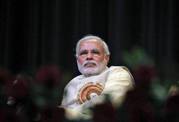 Narendra Modi, prime ministerial candidate for the main opposition Bharatiya Janata Party (BJP) and Gujarat's chief minister, attends the Confederation of All India Traders (CAIT) national convention in New Delhi February 27, 2014. REUTERS/Stringer/Files
