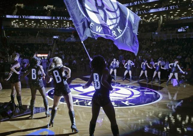 The Brooklynettes perform during introductions before the Brooklyn Nets play the Utah Jazz in their NBA basketball game in New York, December 18, 2012. REUTERS/Ray Stubblebine