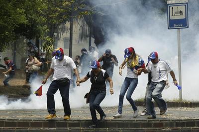 Soldier, pregnant woman killed in Venezuela unrest