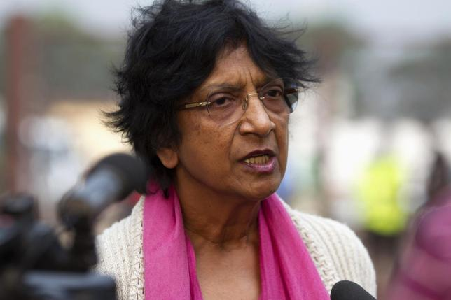 United Nations High Commissioner for Human Rights Navi Pillay addresses media on her arrival at the airport of the capital Bangui March 18, 2014. REUTERS/Siegfried Modola