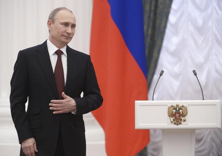 Russian President Vladimir Putin takes part in a state awards ceremony in Moscow's Kremlin March 24, 2014. REUTERS/Alexei Nikolskiy/RIA Novosti/Kremlin