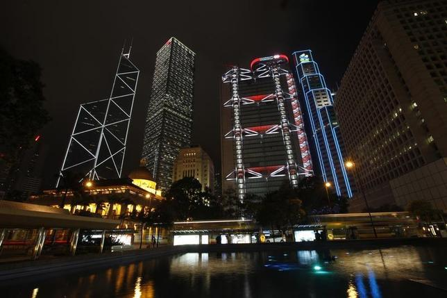 Hong Kong's central financial district's (L-R) Bank of China Tower, Cheung Kong Centre, HSBC headquarters, Standard Chartered Bank and Legislative Council (front L) are pictured lighted up before Earth Hour March 31, 2012. REUTERS/Tyrone Siu