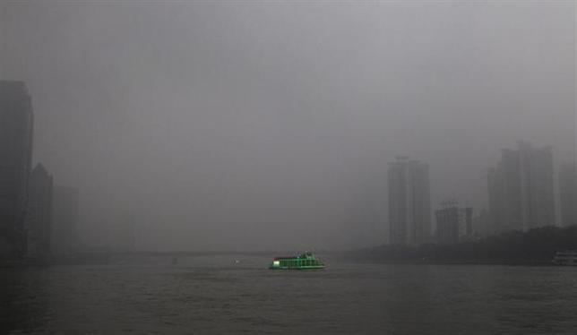 A tourist boat, decorated with green lights, travels on the Pearl River amid heavy haze in Guangzhou, Guangdong province March 3, 2014. REUTERS/Alex Lee