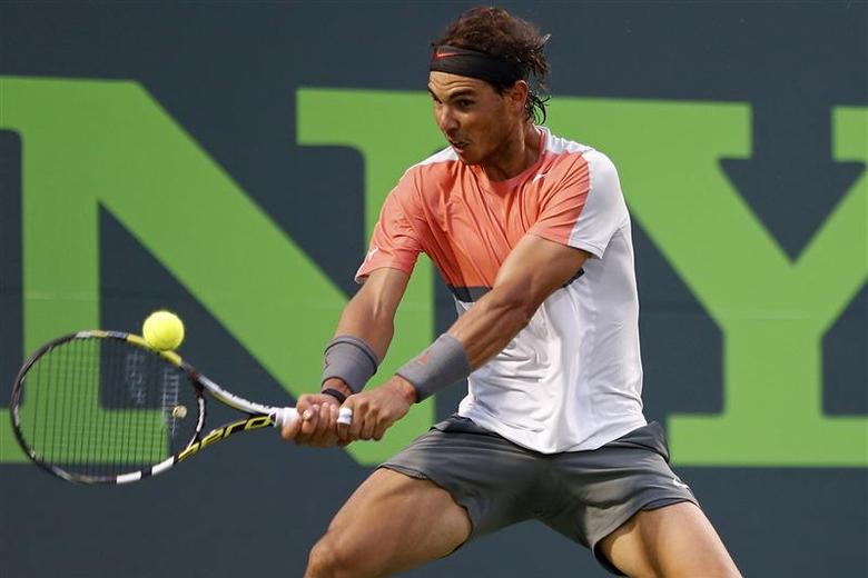 Rafael Nadal hits a backhand against Denis Istomin (not pictured) on day eight of the Sony Open at Crandon Tennis Center. Nadal won 6-1, 6-0. Mandatory Credit: Geoff Burke-USA TODAY Sports