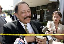 Judge Joe Brown, a television court judge, talks to the media outside the federal court in Ocala, Florida, April 24, 2008. REUTERS/Scott Audette