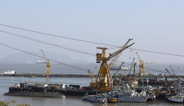 Ships and submarines belonging to the Indian Navy are seen docked at the naval dockyard in Mumbai February 27, 2014. REUTERS/Danish Siddiqui