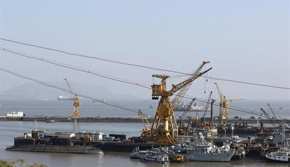 Ships and submarines belonging to the Indian Navy are seen docked at the naval dockyard in Mumbai February 27, 2014. REUTERS/Danish Siddiqui/Files