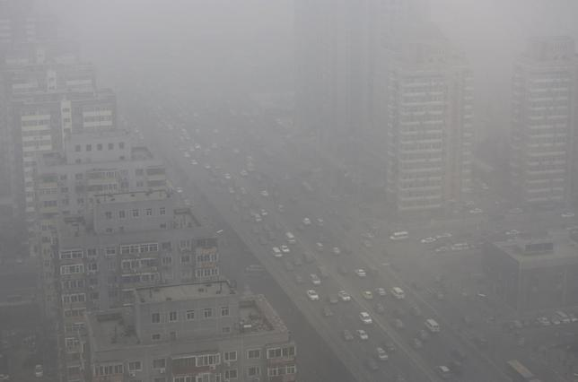 Cars drive on the Three Ring Road amid the heavy haze in Beijing February 26, 2014. REUTERS/Jason Lee