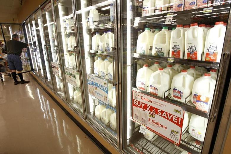 The milk section of a grocery store is pictured in Los Angeles April 7, 2011. REUTERS/Mario Anzuoni
