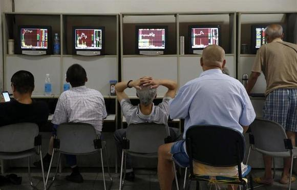 Investors look at computer screens showing stock information at a brokerage house in Shanghai August 16, 2013. REUTERS/Stringer/Files