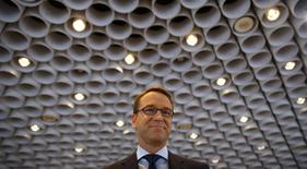 Jens Weidmann, President of Germany's federal reserve bank Bundesbank arrives for the bank's annual news conference in Frankfurt, March 13 2014. REUTERS/Kai Pfaffenbach