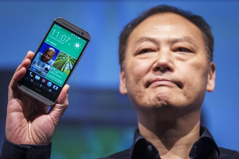 HTC CEO Peter Chou shows the new HTC one (M8) phone during a launch event in New York, March 25, 2014. REUTERS/Brendan McDermid