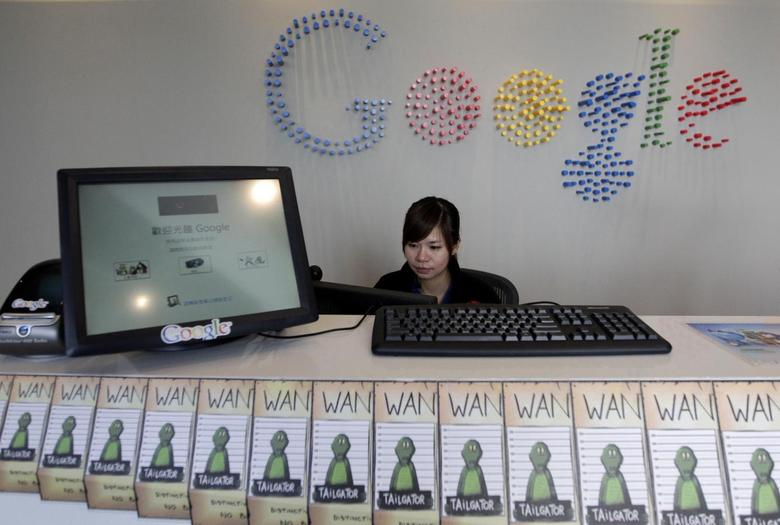 An employee sits behind a reception desk during a media tour in the Google data centre in Changhua Coastal Industrial Park, central Taiwan, December 11, 2013. REUTERS/Pichi Chuang