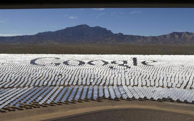 The Google logo is spelled out in heliostats (mirrors that track the sun and reflect the sunlight onto a central receiving point) during a tour of the Ivanpah Solar Electric Generating System in the Mojave Desert near the California-Nevada border February 13, 2014. REUTERS/Steve Marcus/Files