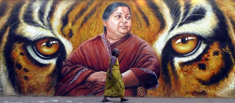 A woman walks in front of a portrait of Jayalalithaa, a former film actress and now head of the state opposition party, the All India Anna Dravida Munnetra Kazhagam (AIADMK), in the southern Indian city of Chennai March 2, 2009. REUTERS/Babu