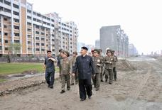 North Korean leader Kim Jong-un inspects the construction site of the apartment houses for scientists close to completion in this undated file photo released by North Korea's Korean Central News Agency (KCNA) in Pyongyang in this August 7, 2013 file photo. REUTERS/KCNA/Files