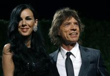 Designer L'Wren Scott and rock musician Mick Jagger pose as they arrive at the 2009 Vanity Fair Oscar Party in West Hollywood, California February 22, 2009. REUTERS/Danny Moloshok