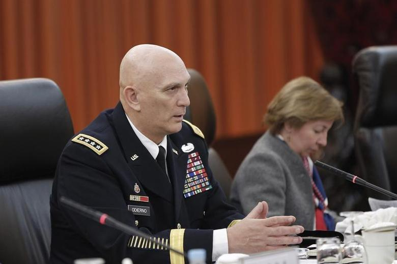 U.S. Army Chief of Staff General Ray Odierno (L) speaks during a meeting with Fang Fenghui (not pictured), Chief of General Staff of the People's Liberation Army, at Bayi Building in Beijing February 21, 2014. REUTERS/Lintao Zhang/Pool