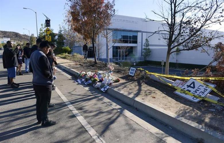 Fans place flowers at the scene of the car crash where actor Paul Walker was killed in the Santa Clarita area of Los Angeles December 1, 2013. REUTERS/Phil McCarten