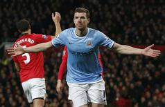 Manchester City's Edin Dzeko celebrates his second goal against Manchester United during their English Premier League soccer match at Old Trafford in Manchester, northern England March 25, 2014. REUTERS/Phil Noble