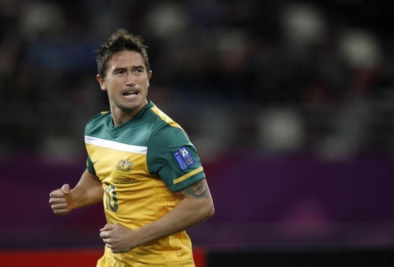 Australia's Harry Kewell celebrates after scoring against Uzbekistan during their 2011 Asian Cup semi-final soccer match at Khalifa stadium in Doha January 25, 2011. REUTERS/Fadi Al-Assaad