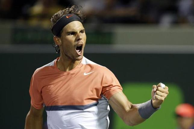 Mar 25, 2014; Miami, FL, USA; Rafael Nadal celebrates after his match against Fabio Fognini (not pictured) on day nine of the Sony Open at Crandon Tennis Center. Nadal won 6-2, 6-2. Mandatory Credit: Geoff Burke-USA TODAY Sports