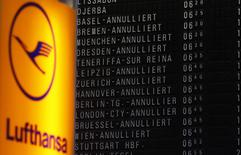 File photo of cancelled flights on a flight schedule board next to the logo of German air carrier Lufthansa at the Fraport airport in Frankfurt, April 22, 2013. REUTERS/Kai Pfaffenbach/Files
