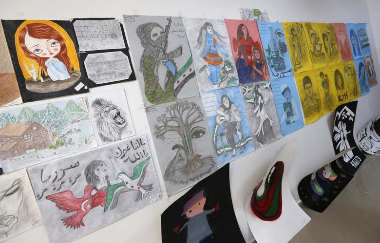 Drawings which were made by Syrian refugee women are seen in a showroom at a refugee camp in Nizip in Gaziantep province, near the Turkish-Syrian border March 17, 2014. REUTERS/Murad Sezer