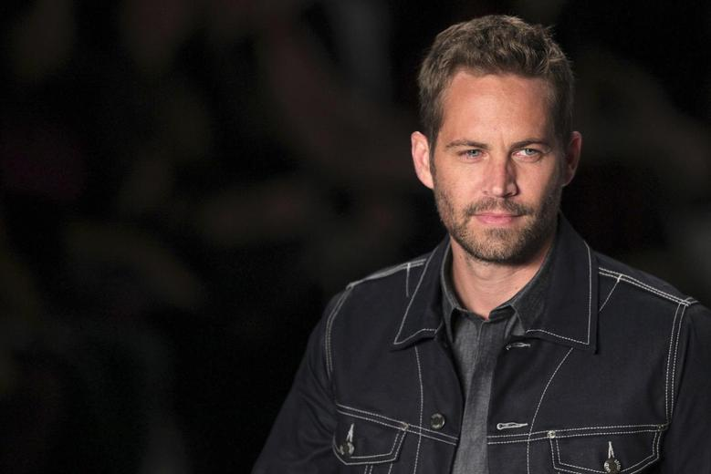 U.S. actor Paul Walker presents a creation from Colcci's 2013/2014 summer collection during Sao Paulo Fashion Week in this March 21, 2013 file photo. REUTERS/Filipe Carvalho