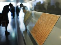 A visitor looks at the pages of Anne Frank's other diaries on display in the Anne Frank House in Amsterdam April 28, 2010. REUTERS/Cris Toala Olivares