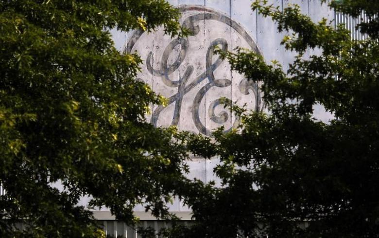 A faded, painted logo sits over the entrance to a General Electric Co. facility in Medford, Massachusetts July 17, 2009. REUTERS/Brian Snyder