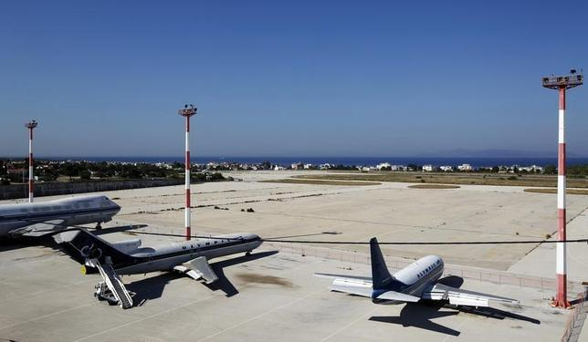 Disused aircrafts are seen on the tarmac of the old Athens' airport at Hellenikon suburb, southwest of Athens June 20, 2011. REUTERS/Yiorgos Karahalis