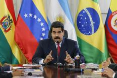 Venezuela's President Nicolas Maduro speaks to the Union of South American Nations' (UNASUR) foreign ministers at Miraflores palace in Caracas March 25, 2014. REUTERS/Jorge Silva