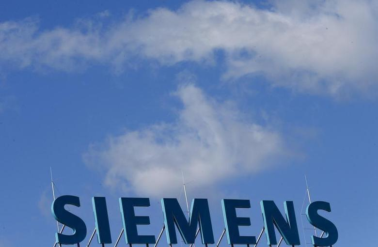 The company logo of Siemens AG is pictured atop an office building in Berlin September 30, 2013. REUTERS/Tobias Schwarz