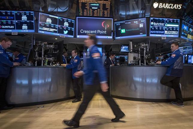 Traders work on the floor of the New York Stock Exchange March 24, 2014. REUTERS/Brendan McDermid