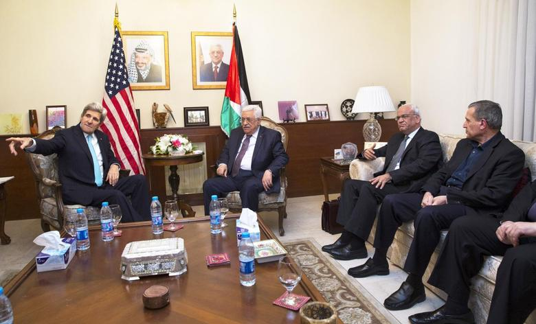 U.S. Secretary of State John Kerry (L), meets with Palestinian President Mahmoud Abbas, at the Palestinian AmbassadorÕs Residence in Amman, Jordan March 26, 2014, in an effort to salvage the Middle East peace talks as a breakdown looms. REUTERS/Jacquelyn Martin