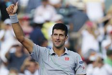 Mar 26, 2014; Miami, FL, USA; Novak Djokovic waves to the crowd after his match against Andy Murray (not pictured) on day ten of the Sony Open at Crandon Tennis Center. Geoff Burke-USA TODAY Sports