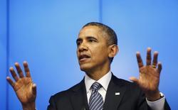 Президент США Барак Обама выступает на пресс-конференции в Брюсселе 26 марта 2014 года. Россия не будет вытеснена из Крыма военной силой, но, если Запад будет един, Москва осознает, что не сможет добиться безопасности грубой силой, сказал президент США Барак Обама. REUTERS/Kevin Lamarque