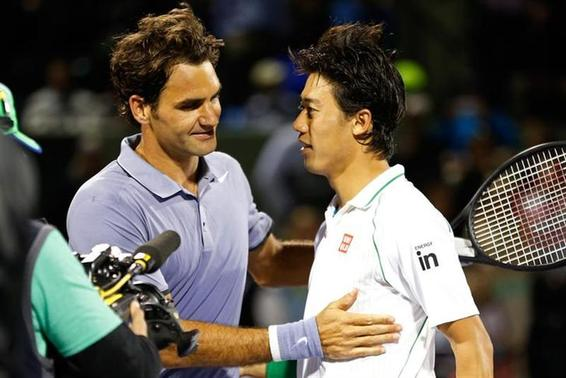 Mar 26, 2014; Miami, FL, USA; Kei Nishikori (R) shakes hands with Roger Federer (L) after their match on day ten of the Sony Open at Crandon Tennis Center. Nishikori won 3-6, 7-5, 6-4. Mandatory Credit: Geoff Burke-USA