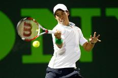 Mar 26, 2014; Miami, FL, USA; Kei Nishikori hits a forehand against Roger Federer (not pictured) on day ten of the Sony Open at Crandon Tennis Center. Geoff Burke-USA TODAY Sports