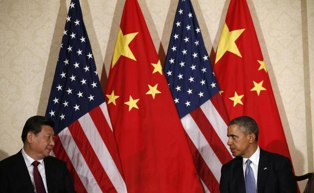 U.S. President Barack Obama (R) meets China's President Xi Jinping, on the sidelines of a nuclear security summit, in The Hague March 24 2014. REUTERS/Kevin Lamarque