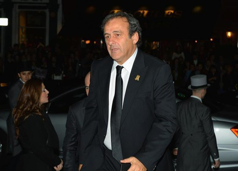 UEFA president Michel Platini arrives to attend the FA150 Gala Dinner commemorating the Football Association's 150th year at the Grand Connaught Rooms in London October 26, 2013. REUTERS/Leon Neal/Pool