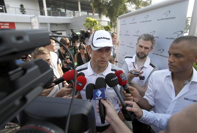 McLaren Formula One driver Jenson Button of Britain speaks to journalists ahead of the Malaysian F1 Grand Prix at Sepang International Circuit outside Kuala Lumpur March 27, 2014. REUTERS/Samsul Said