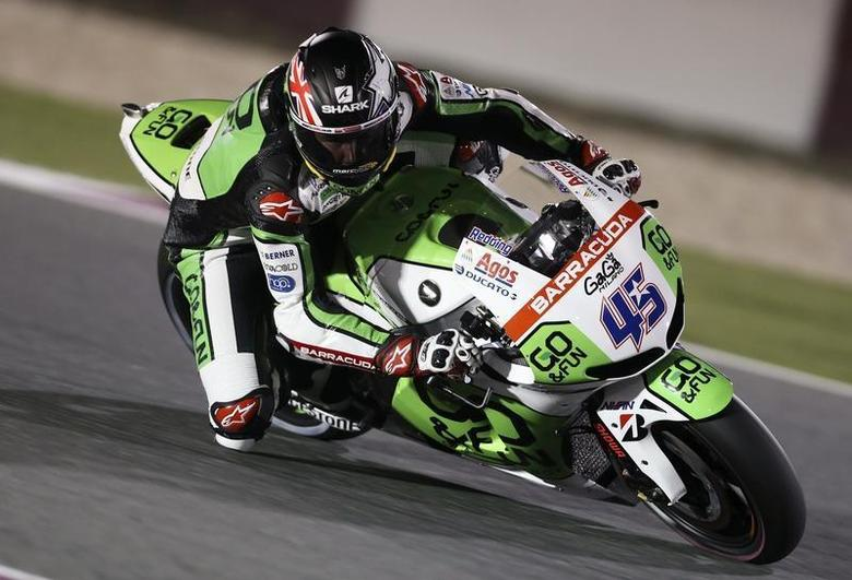 Go&Fun Honda Gresini Scott Redding of Britain rides his bike during a free practice session at the MotoGP World Championship at the Losail International circuit in Doha March 21, 2014. REUTERS/Fadi Al-Assaad