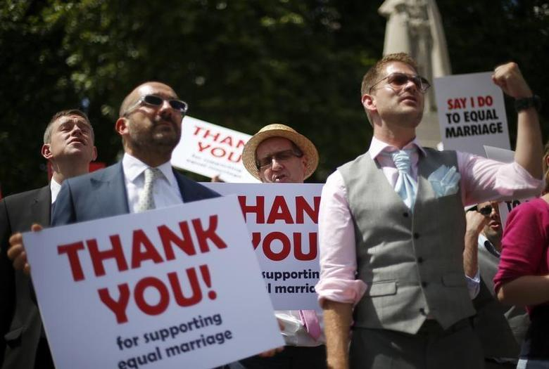Members of the London Gay Men's Choir perform in front of the Houses of Parliament in central London July 15, 2013. REUTERS/Andrew Winning/Files