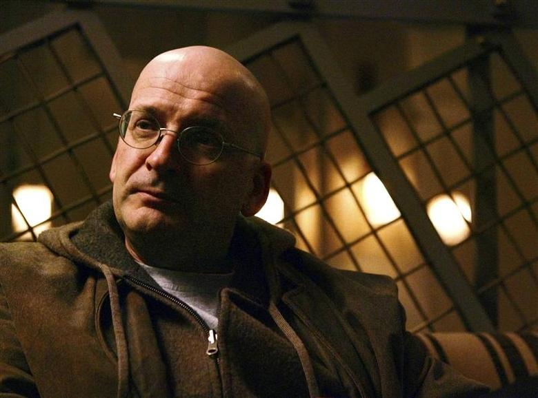 Irish author Roddy Doyle poses at the Soho Grand Hotel in Manhattan, in this November 8, 2004 file photo. REUTERS/Mike Segar/files